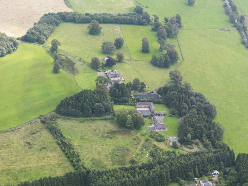 General oblique aerial view of Mossknowe House and policies, taken from the NW.