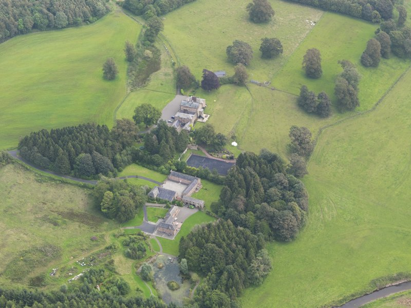 General oblique aerial view of Mossknowe House and policies, taken from the W.