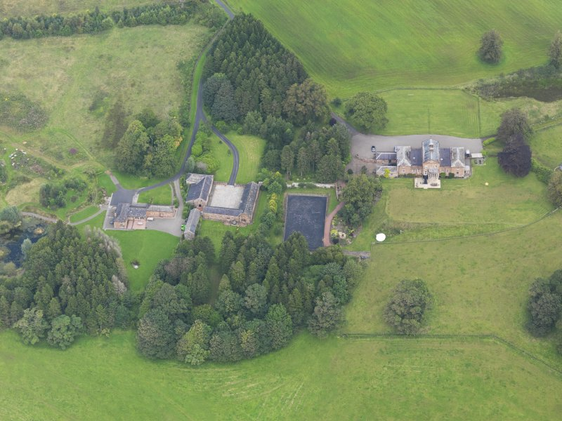 Oblique aerial view of Mossknowe House and policies, taken from the SSW.