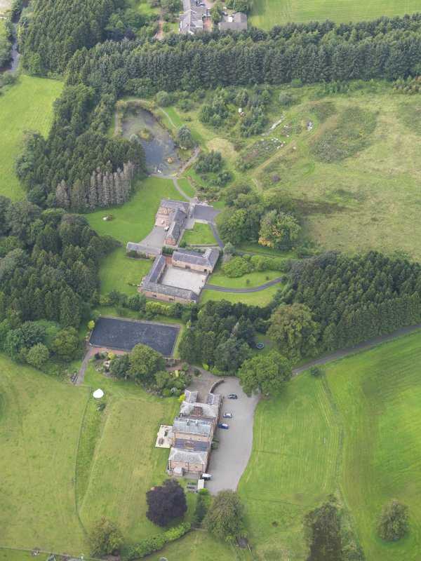 Oblique aerial view of Mossknowe House and policies, taken from the ESE.