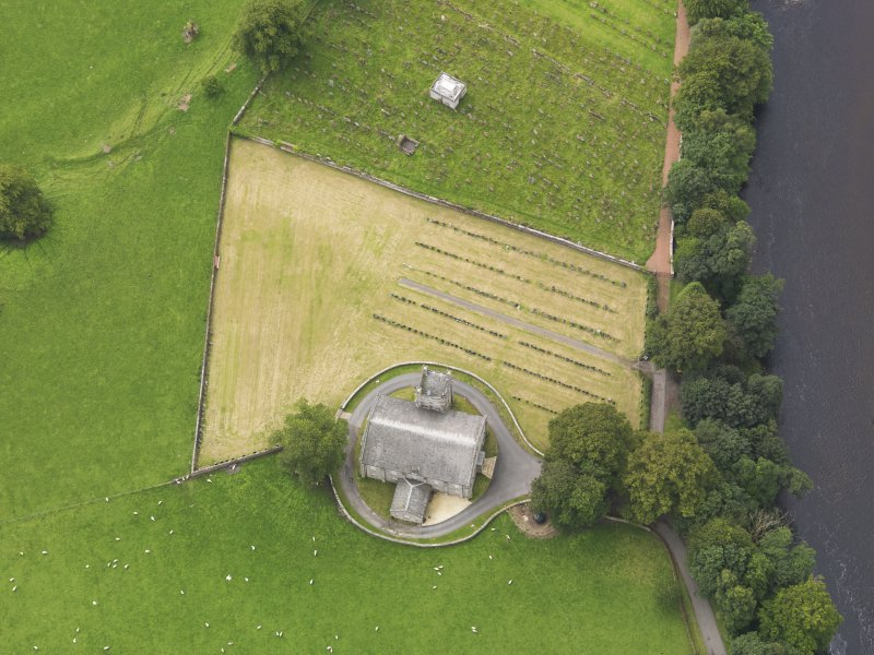 Oblique aerial view of Canonbie Parish Church, taken from the NE.