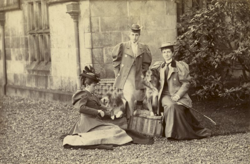 View of three ladies with dogs outside St Fort House.