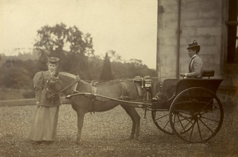 View of two ladies with a pony and trap outside St Fort House.