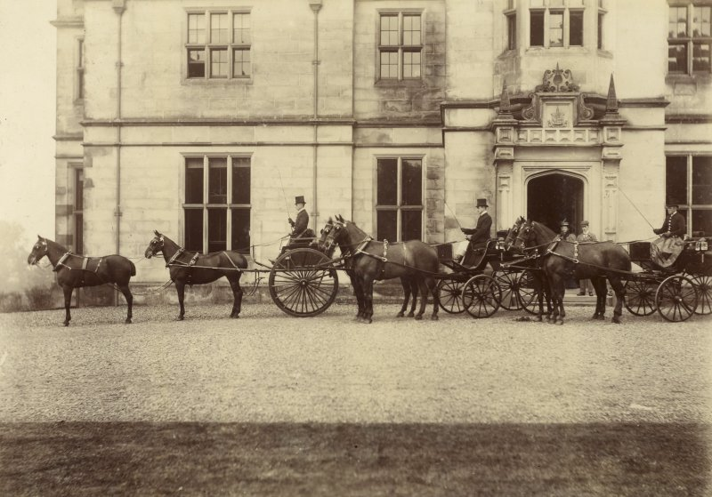 View of three horse-drawn carriages outside St Fort House.