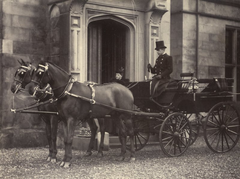 View of driver and carriage with two horses outside St Fort House.