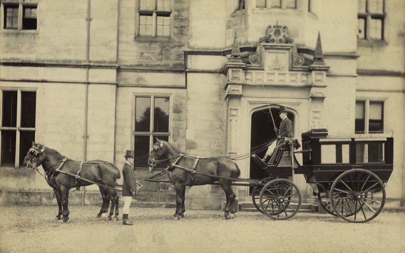 View of two drivers and carriage with four horses outside St Fort House.