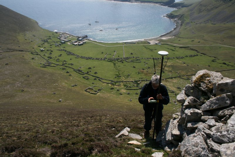 St Kilda, Hirta. Ian Parker of RCAHMS undertaking GPS mapping survey of a cleit on Conachair.