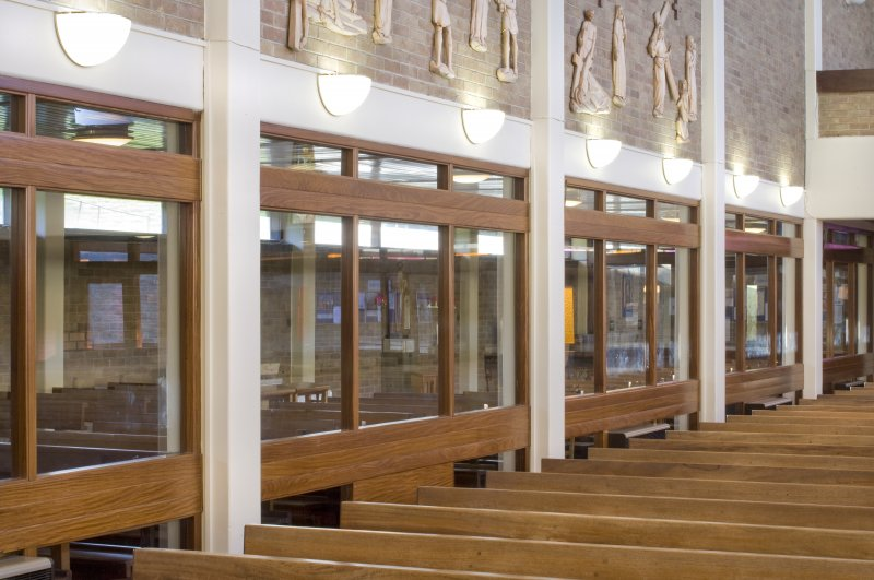 Interior. Glass partition to side chapel from north east.