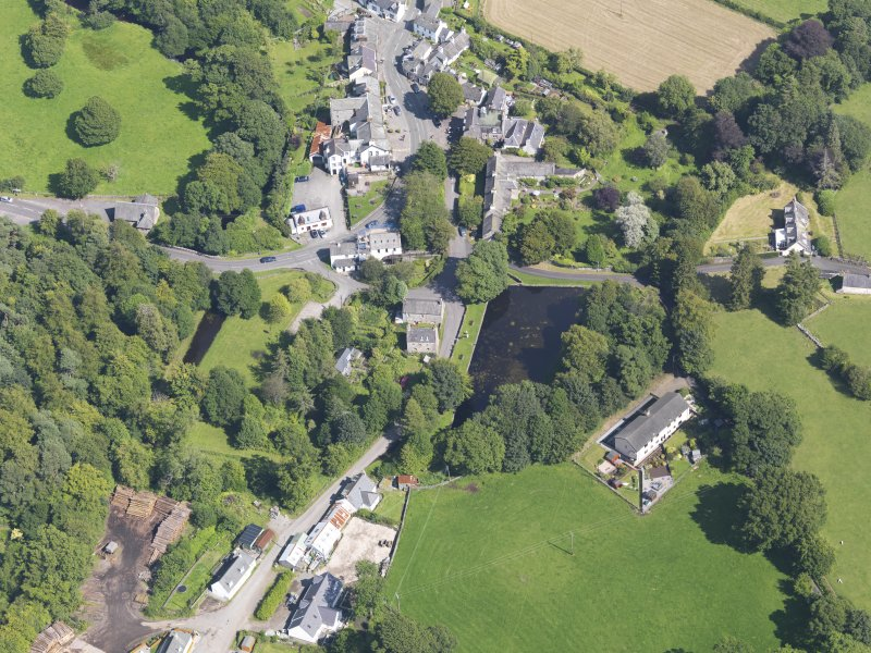 Oblique aerial view of New Abbey, centred on the parish hall, taken from the W.