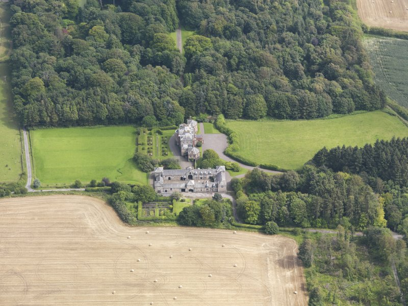 Oblique aerial view of Arbigland House and stables, taken from the NW.