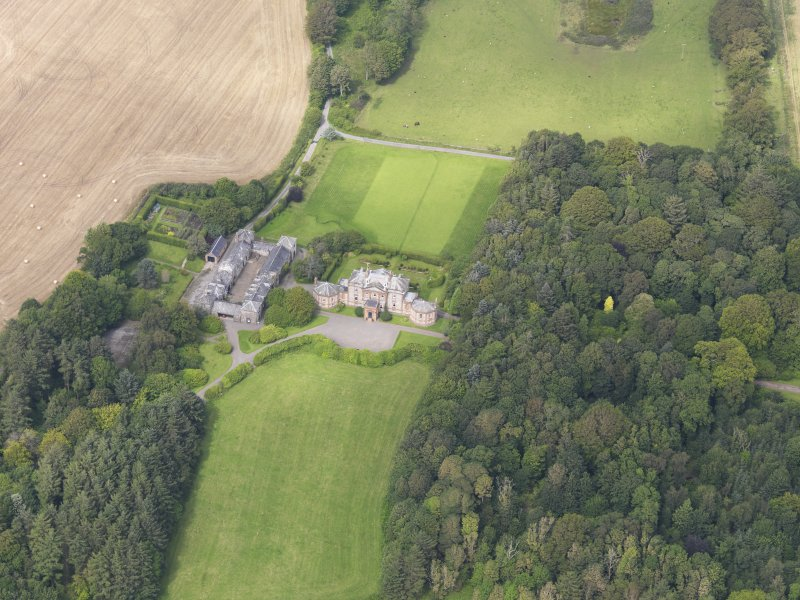 Oblique aerial view of Arbigland House and stables, taken from the SSW.