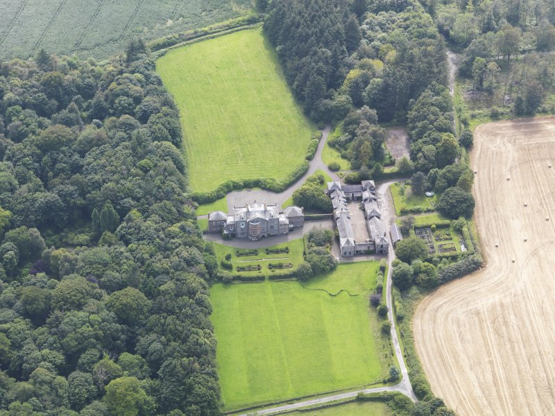 Oblique aerial view of Arbigland House and stables, taken from the NE.