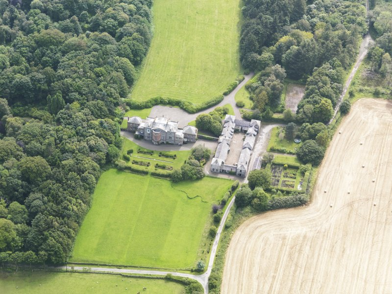 Oblique aerial view of Arbigland House and stables, taken from the NNE.