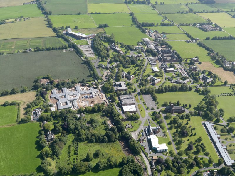 General oblique aerial view of Crichton Royal Hospital, taken from the NNW.