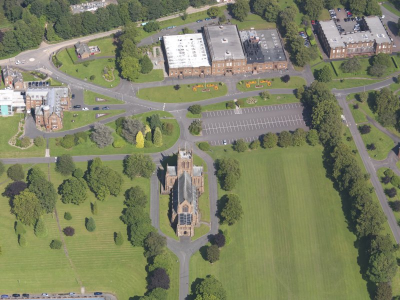 Oblique aerial view of Crichton Royal Hospital, centred on Crichton Memorial Church, taken from the WSW.