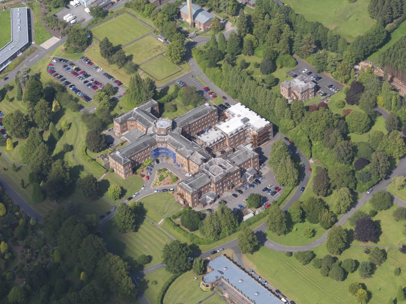 Oblique aerial view of Crichton Royal Hospital, centred on Crichton Hall, taken from the SSW.