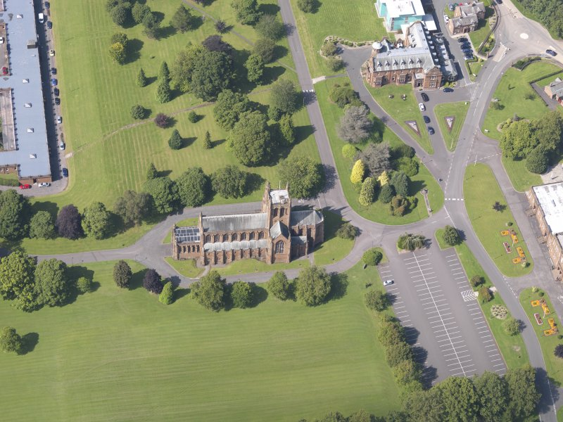 Oblique aerial view of Crichton Royal Hospital, centred on Crichton Memorial Church, taken from the SSE.