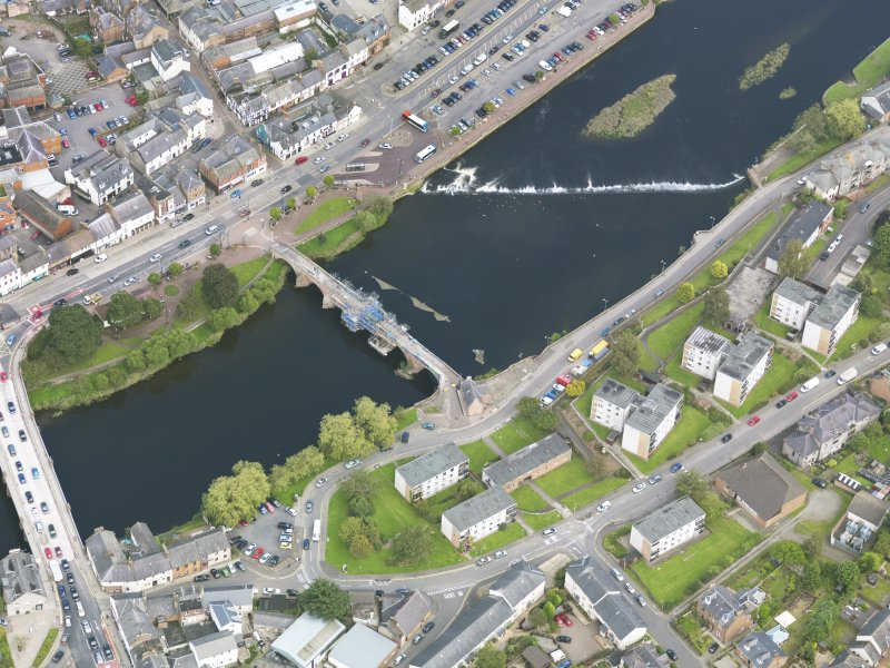 Oblique aerial view of Dumfries, centred on Old Bridge, taken from the W.