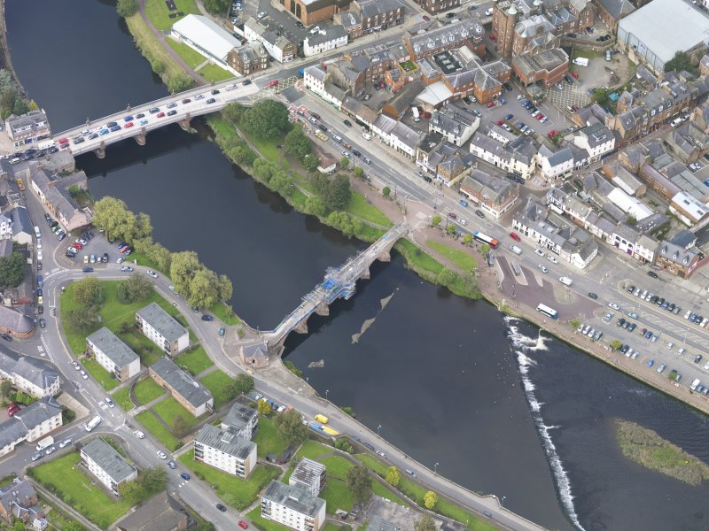 Oblique aerial view of Dumfries, centred on Old Bridge, taken from the S.