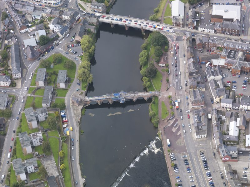 Oblique aerial view of Dumfries, centred on Old Bridge, taken from the SE.