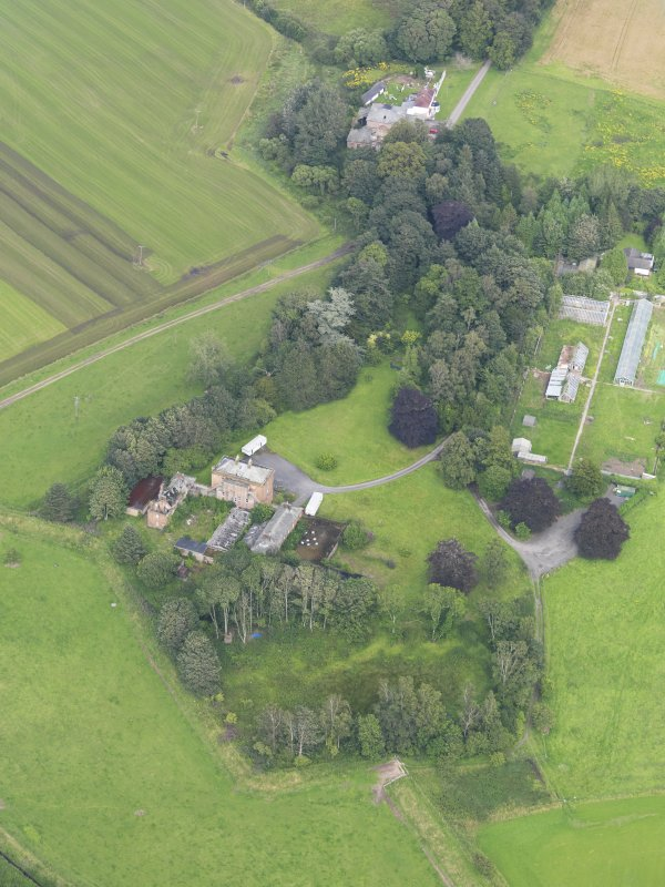 General oblique aerial view of Carnsalloch House and policies, taken from the SW.