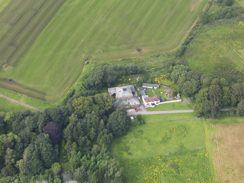 Oblique aerial view of Carnasalloch House stables and cottage, taken from the SSE.