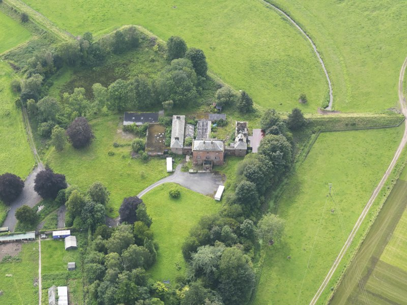 Oblique aerial view of Carnsalloch House, taken from the ENE.