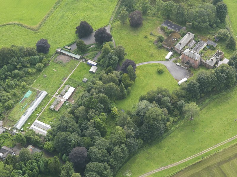 Oblique aerial view of Carnsalloch House and walled garden, taken from the NE.