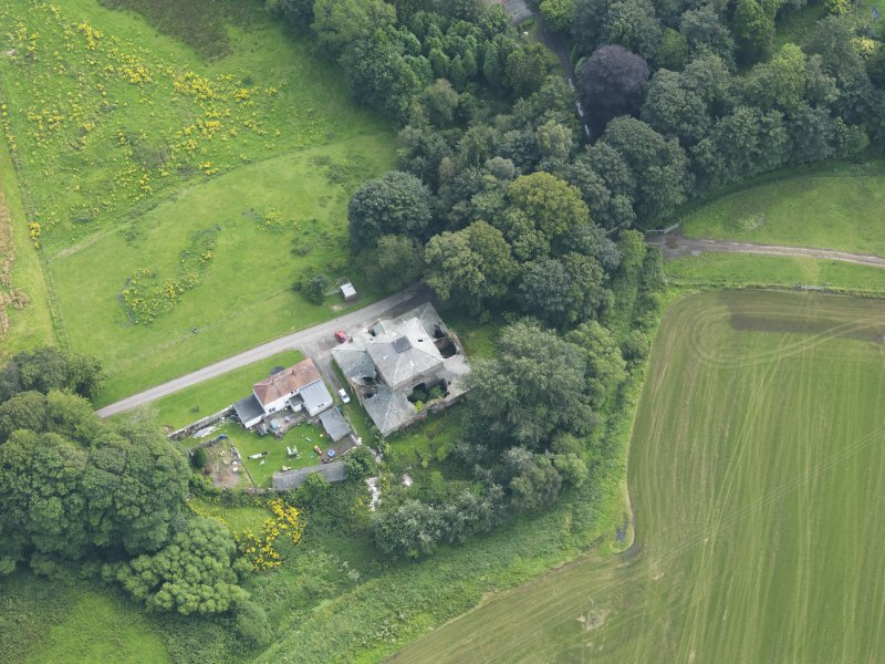 Oblique aerial view of Carnsalloch House stables and cottage, taken from the NNE.