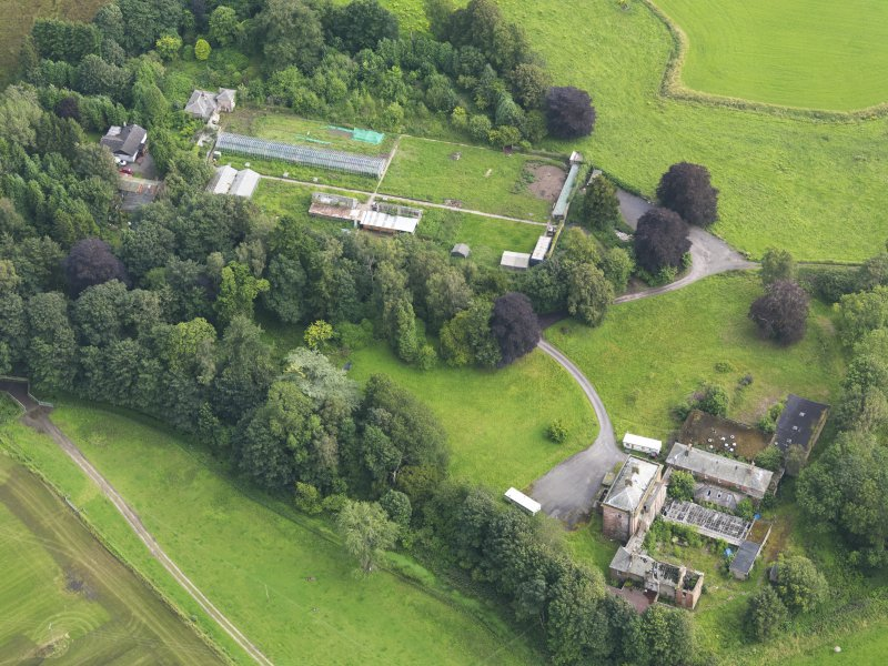 Oblique aerial view of Carnsalloch House and walled garden, taken from the NW.