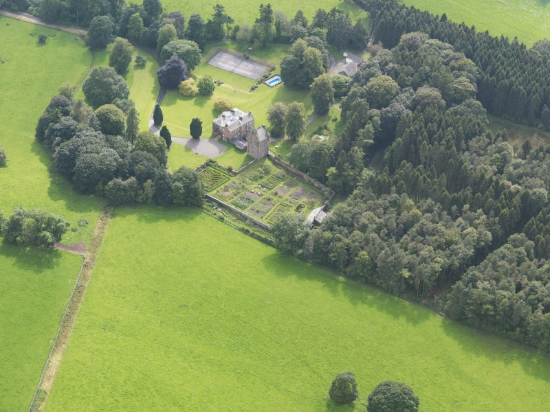 Oblique aerial view of Amisfield House and policies, taken from the NE.