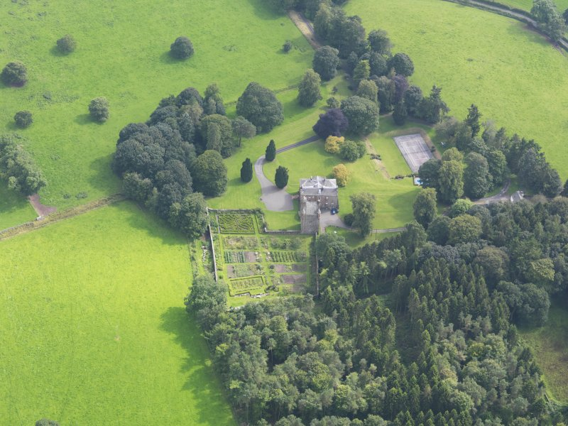 Oblique aerial view of Amisfield House and policies, taken from the NNW.