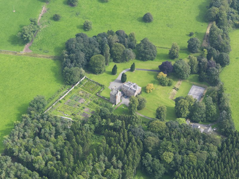 Oblique aerial view of Amisfield House and policies, taken from the NW.