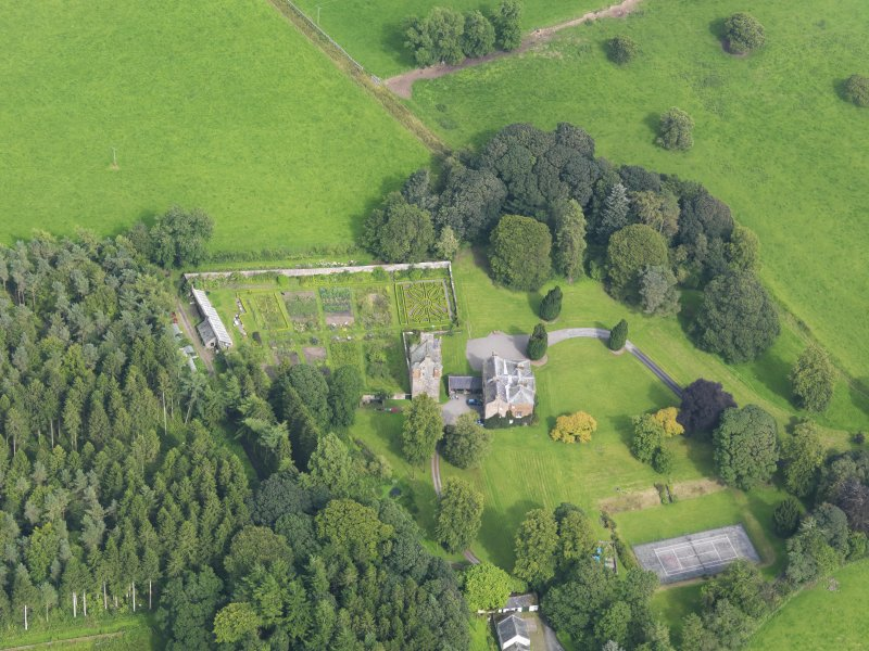 Oblique aerial view of Amisfield House and policies, taken from the W.