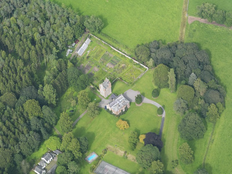 Oblique aerial view of Amisfield House and policies, taken from the SW.