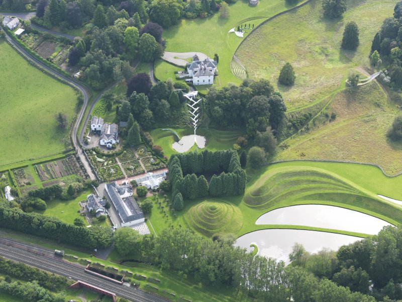 Oblique aerial view of Portrack House and gardens, taken from the NE.