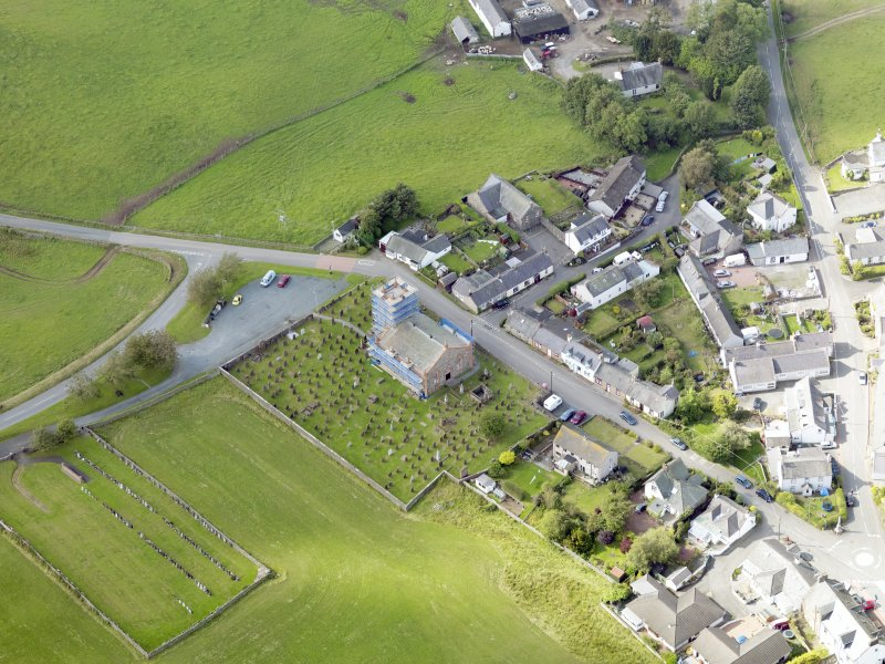 Oblique aerial view of Dunscore Parish Church, taken from the SE.