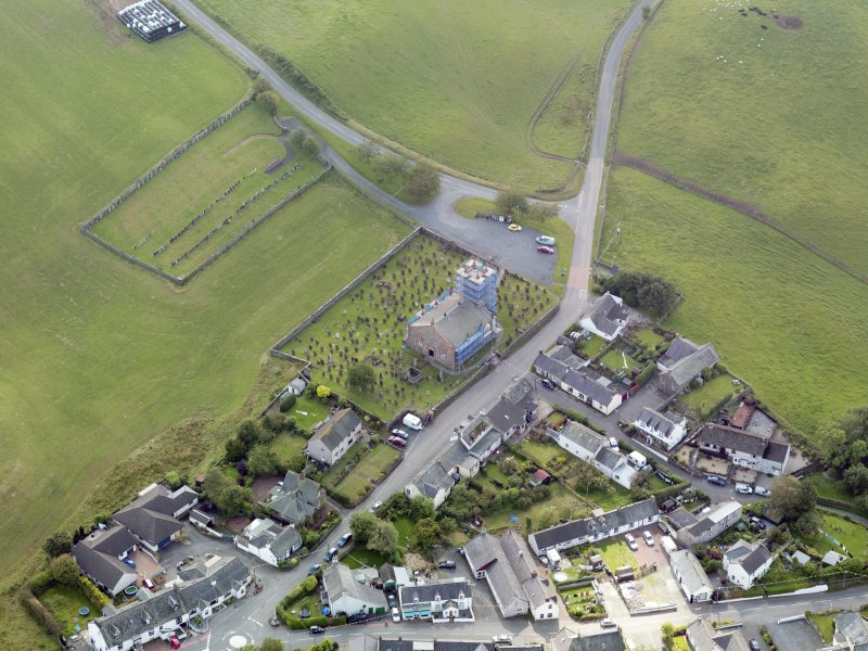 Oblique aerial view of Dunscore Parish Church, taken from the NE.