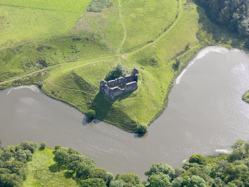 Oblique aerial view of Morton Castle, taken from the NE.
