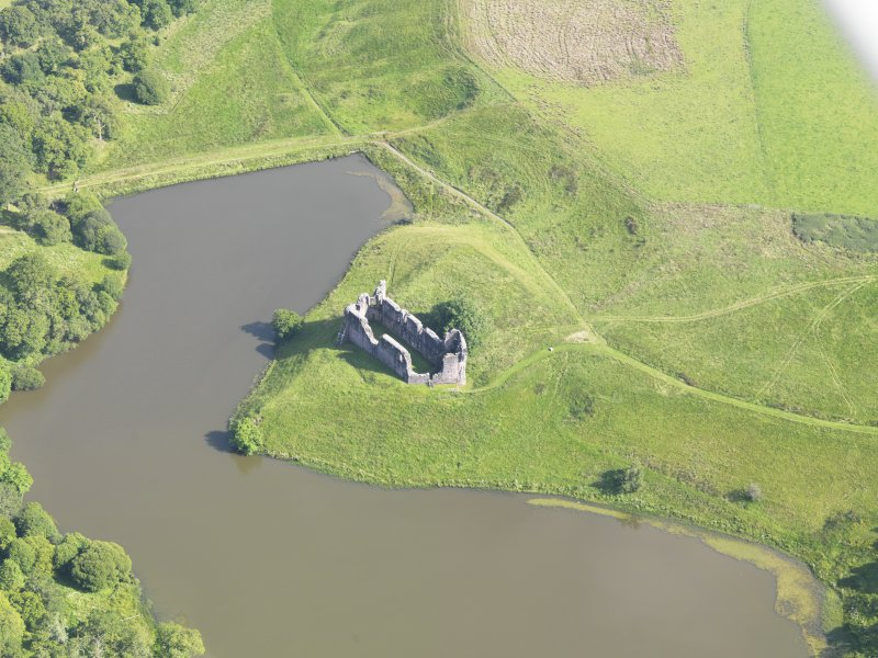 Oblique aerial view of Morton Castle, taken from the NW.