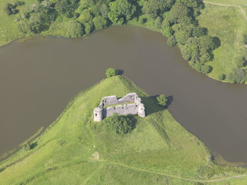 Oblique aerial view of Morton Castle, taken from the SSW.