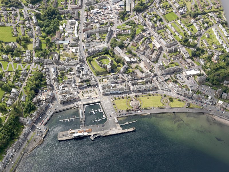 General oblique aerial view of Rothesay, centred on the castle, taken from the NNE.