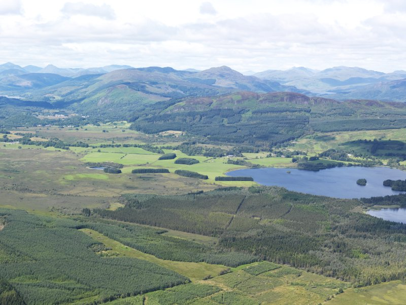 General oblique aerial view looking over the the Lake of Menteith towards the Menteith Hills, taken from the SE.