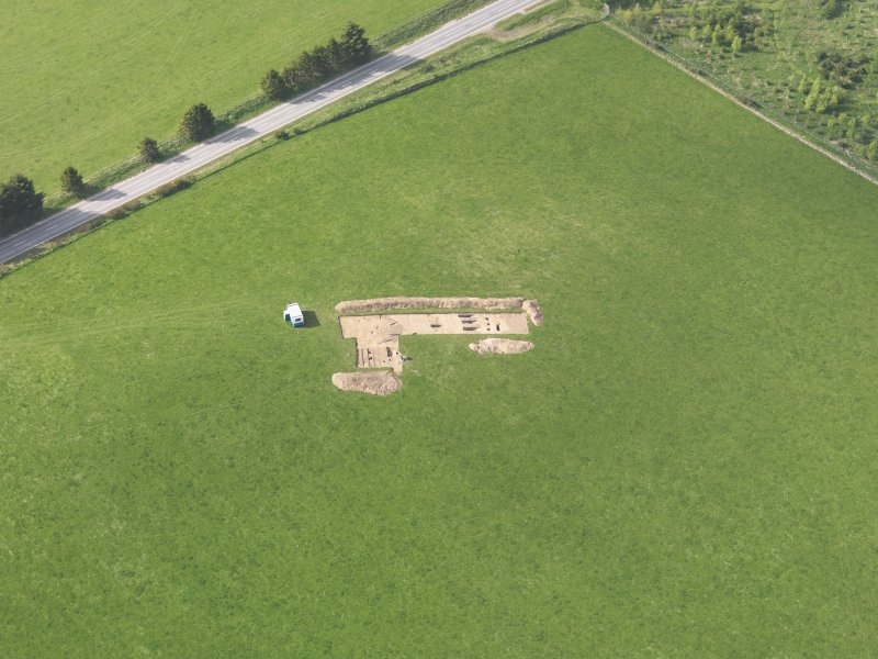 Oblique aerial view centred on the excavation of the enclosures at Barflat, Rhynie, taken from the SE.