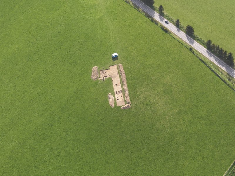 Oblique aerial view centred on the excavation of the enclosures at Barflat, Rhynie, taken from the NE.