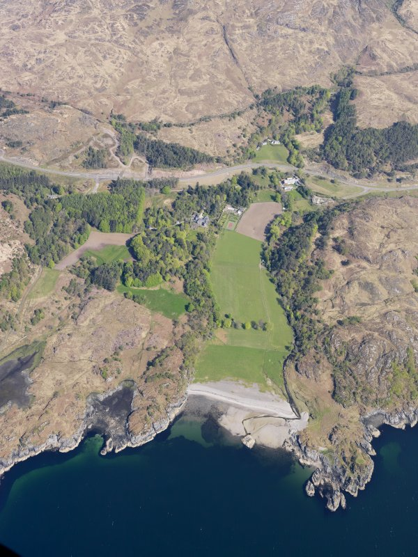 General oblique aerial view of Arisaig House and Borrodale House with the site of Prince Charlie's Cave in the foreground, taken from the SSW.