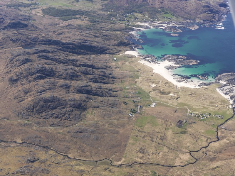 General oblique aerial view of Sanna, taken from the NE.