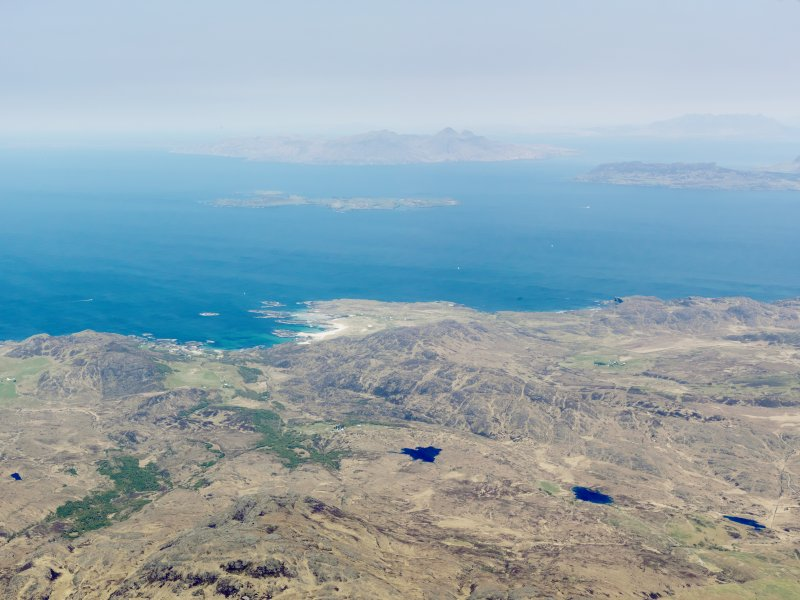 General oblique aerial view of the Islands of Muck, Eigg, Rum and Skye, taken from the SSE.