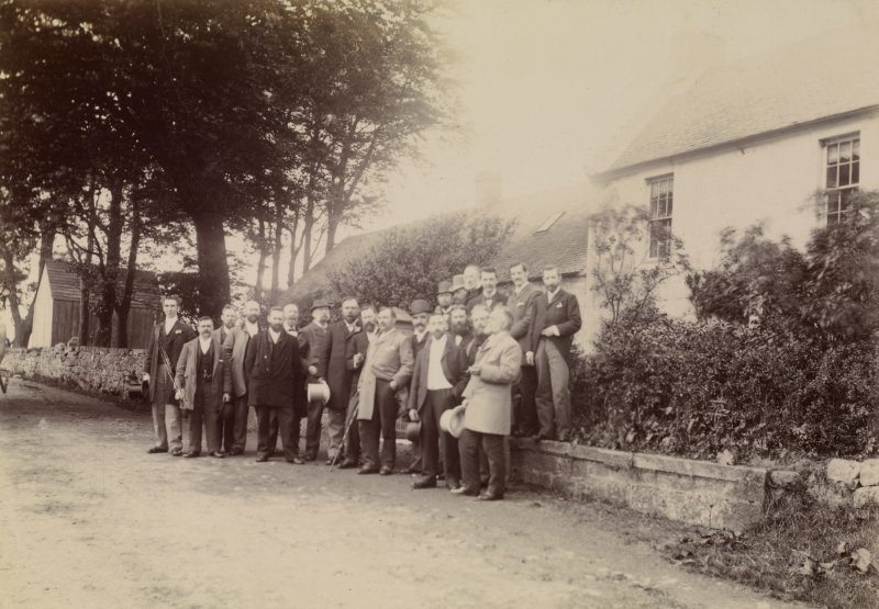Gathering of men in front of house, Long Calderwood. Titled 'LONG CALDERWOOD. BIRTHPLACE OF DRS. JOHN & WILLIAM HUNTER.' PHOTOGRAPH ALBUM NO 11: KIRSTY'S BANFF ALBUM