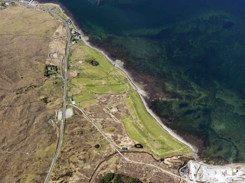 Oblique aerial view of the remains of fish traps near Sconser golf course, and the remains of Achadh Mor township, field system and lazy beds, Skye, taken from the SE.